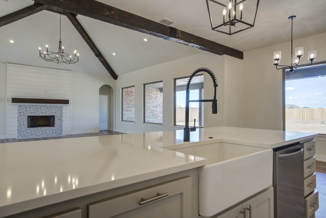 Kitchen with apron sink in new home for sale in the Lubbock area.