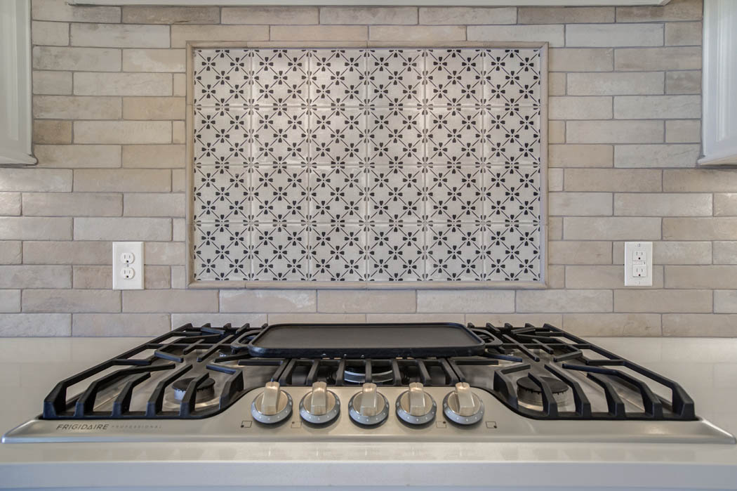 Detail of stove and backsplash in kitchen of new home for sale in West Texas.