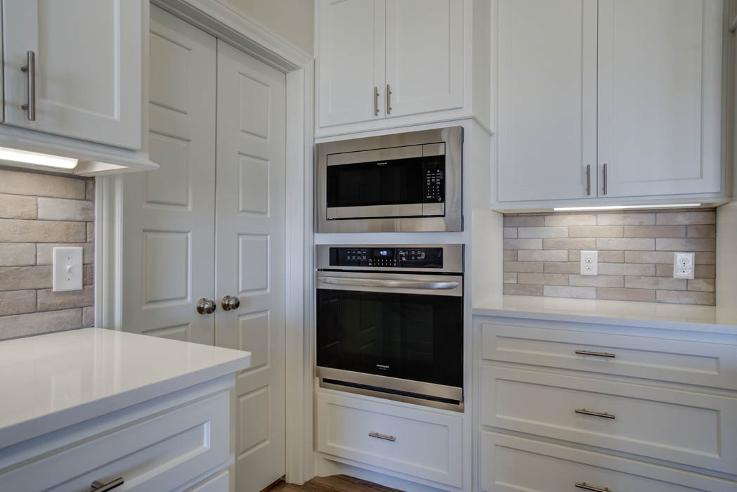 View of kitchen with double oven in new house for sale by Sharkey Custom Homes.