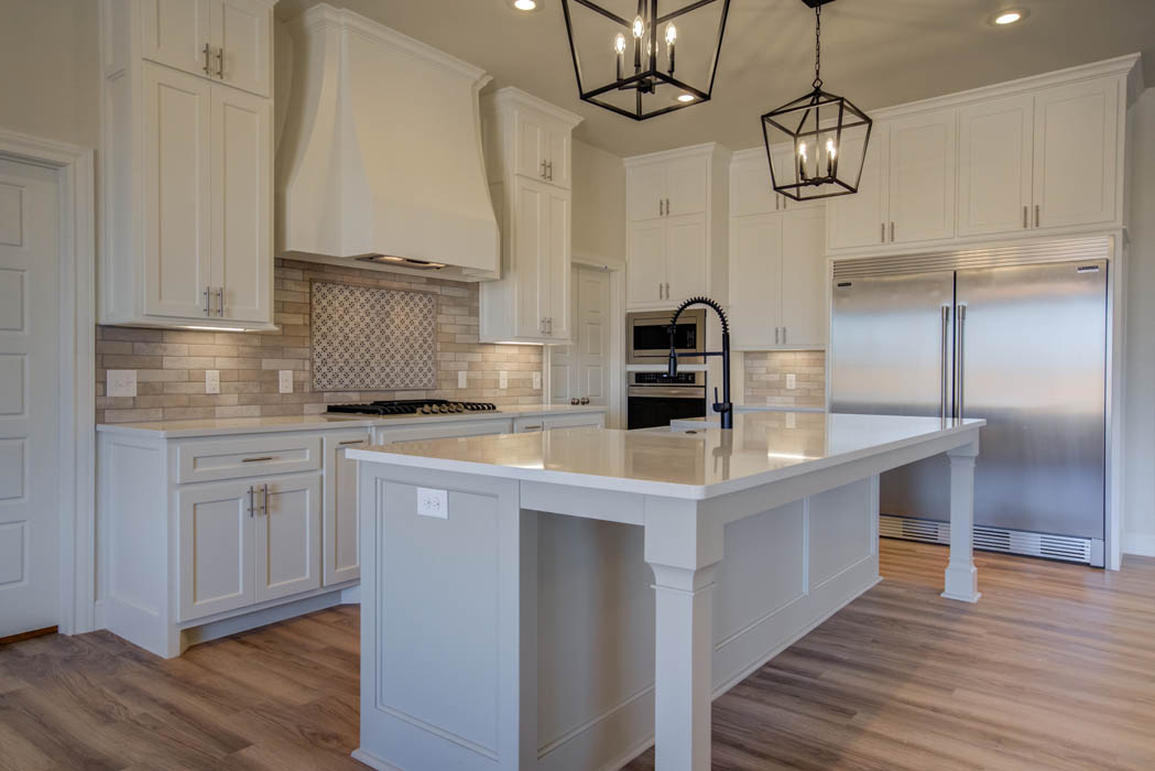 Kitchen in beautiful home for sale featuring double-door refrigerator.