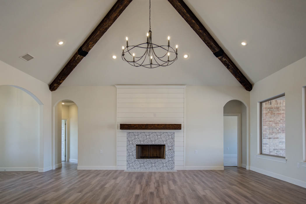 Spacious living room with cozy fireplace in new house in the Lubbock, Texas area.