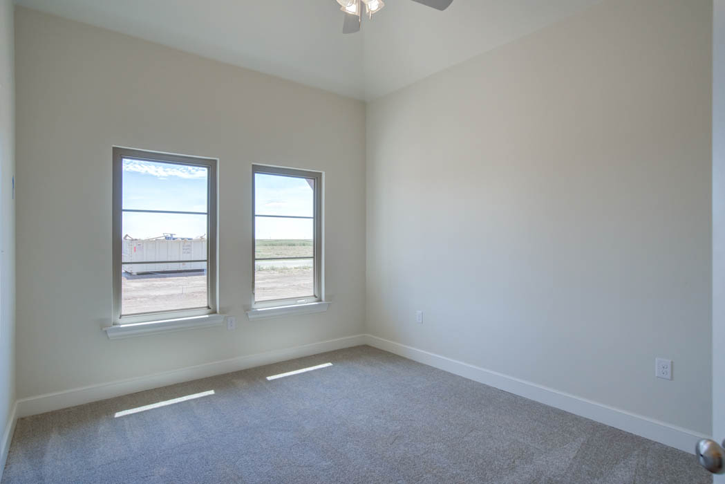 Spacious bedroom in Lubbock area home.