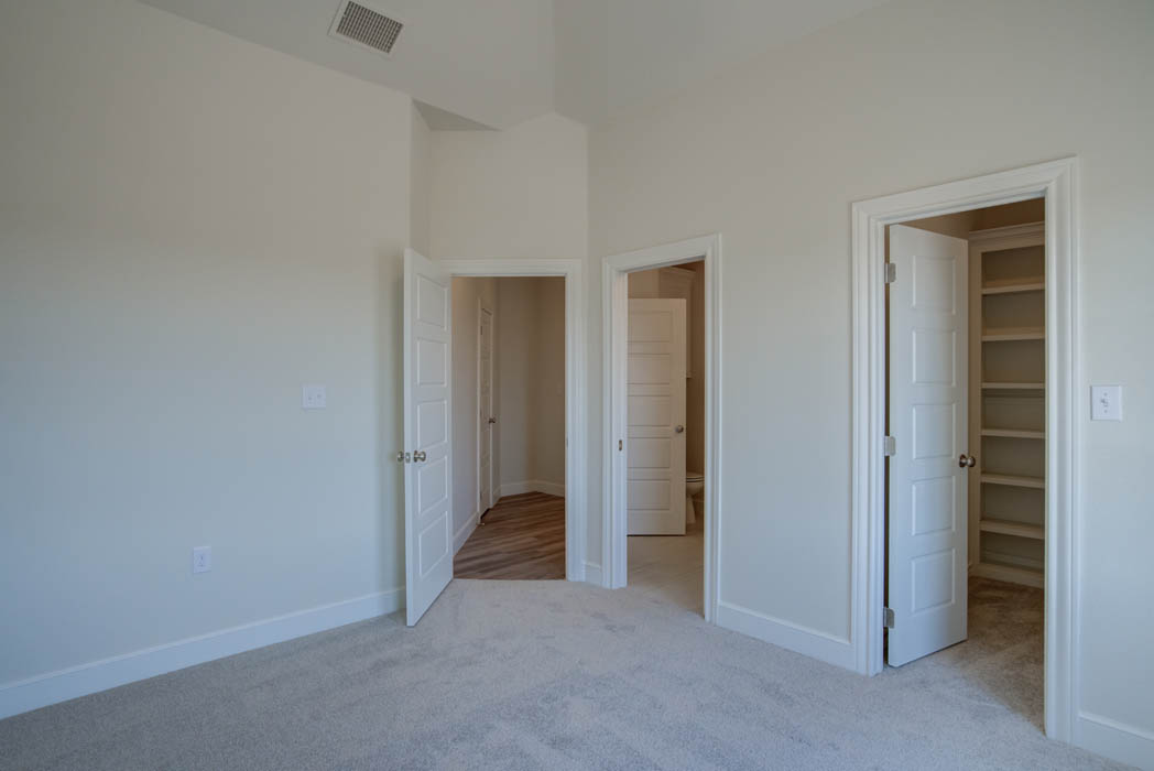 Bedroom in new home for sale near Lubbock, Texas by Sharkey Custom Homes.