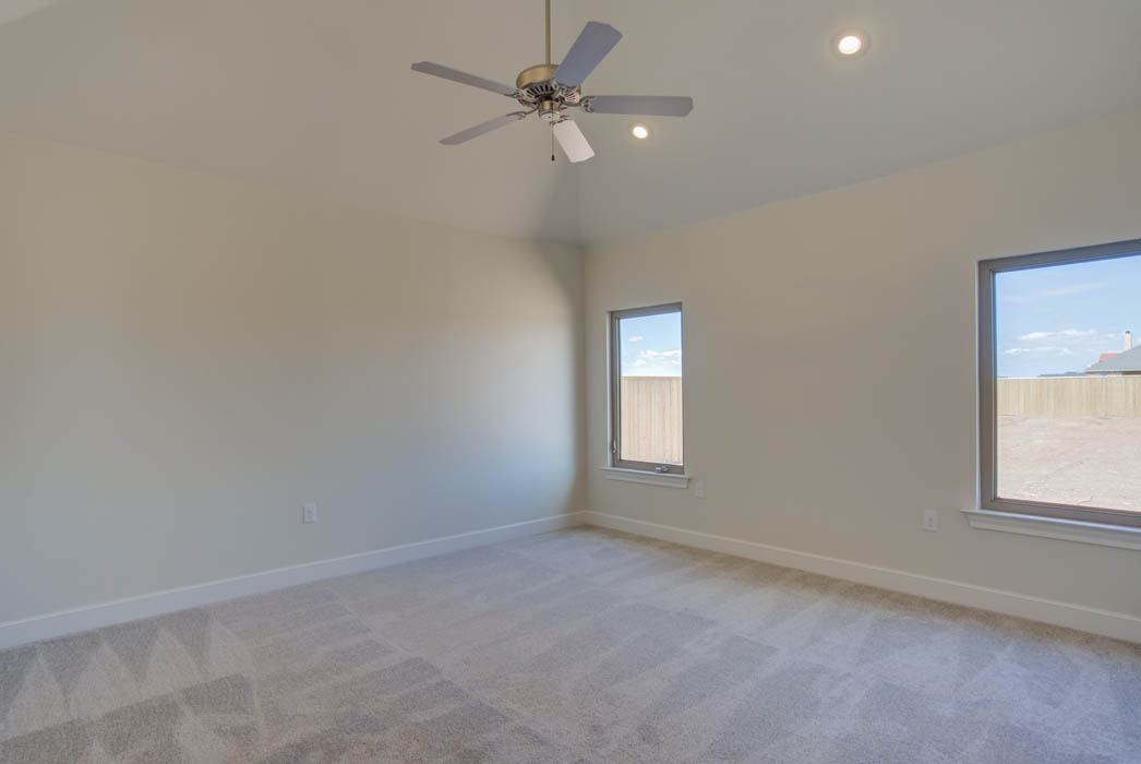 Spacious master bedroom in new home for sale in the Lubbock, Texas area.