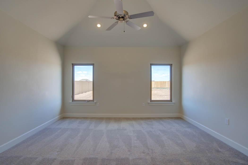 Beautiful bedroom in new home by Sharkey Custom Homes in Lubbock, Texas.