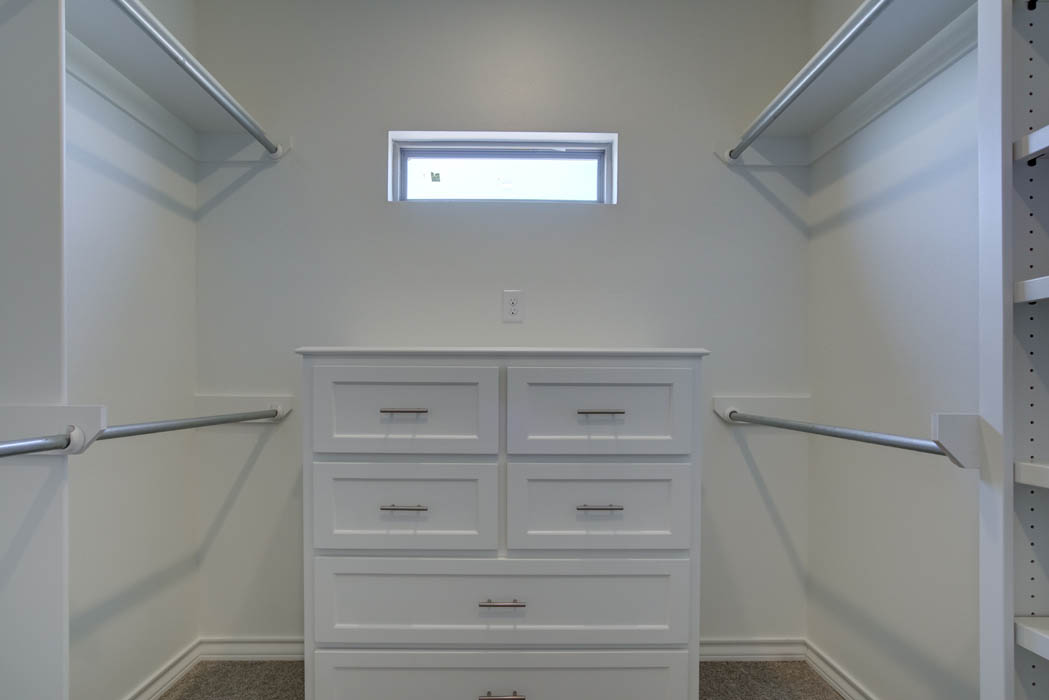 View of master closet in home for sale in The Palms at Kitty Hawk, near Lubbock, Texas.