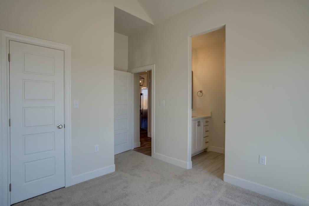 Bedroom in new home in near Lubbock, Texas by Sharkey Custom Homes.