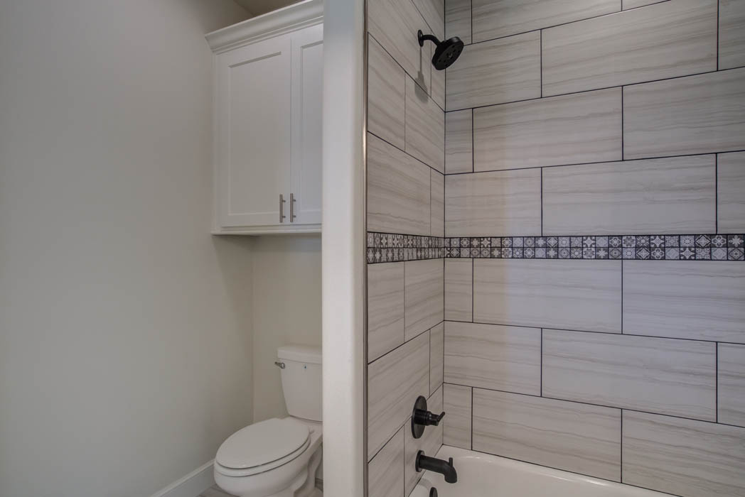 Bath with beautiful tile work in new home in the Lubbock, Texas area.