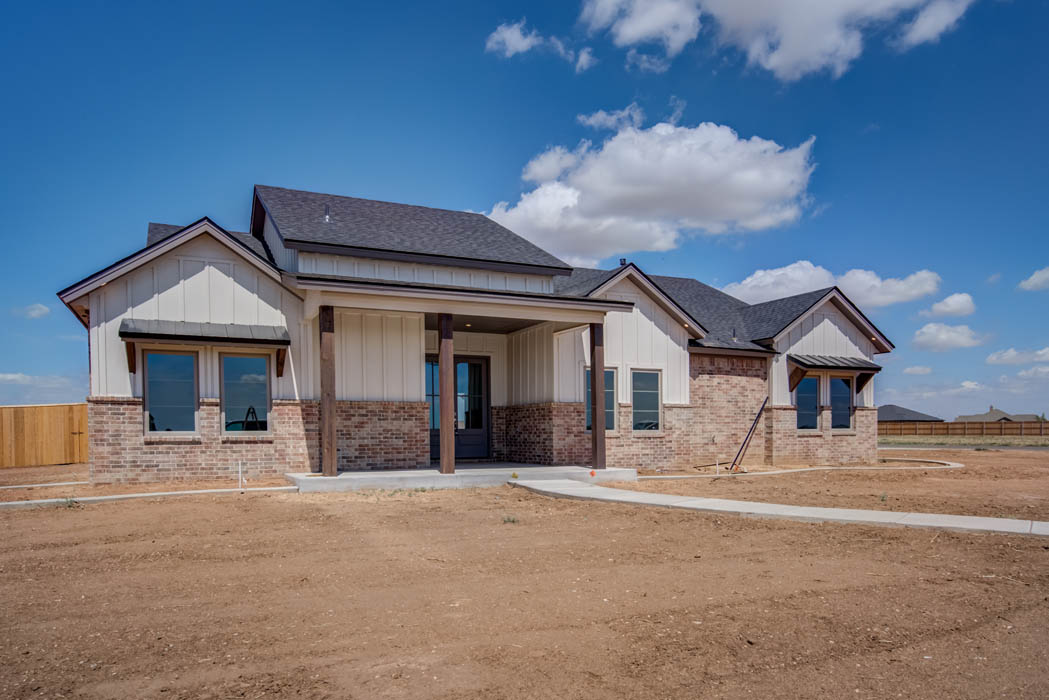 Exterior view of new home in New Home, Texas, by Sharkey Custom Homes.