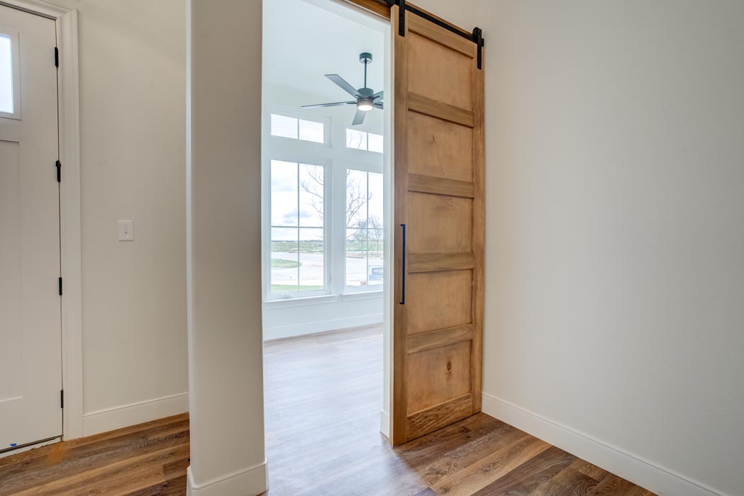 Beautiful warehouse-type sliding doors in new home for sale in Lubbock.