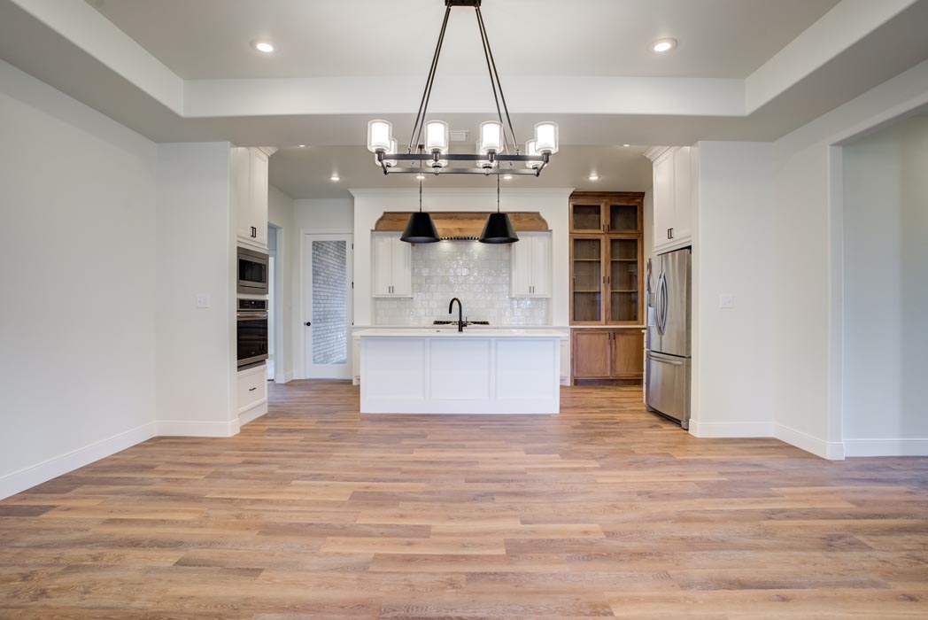 Example of spacious, beautiful dining room in new home built by Sharkey Custom Homes in Lubbock, Texas.
