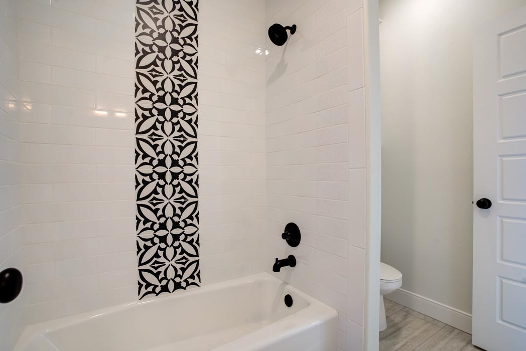 Example of beautiful tile work in bath of new home built by Sharkey Custom Homes in Lubbock, Texas.