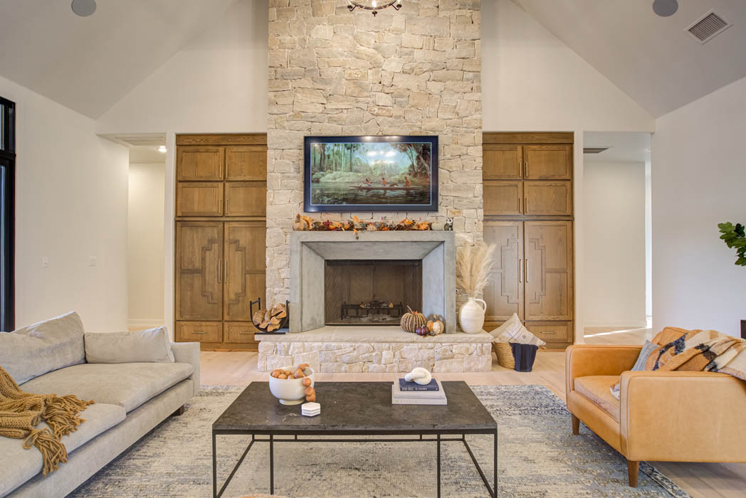 Living area of custom home, featuring fireplace.