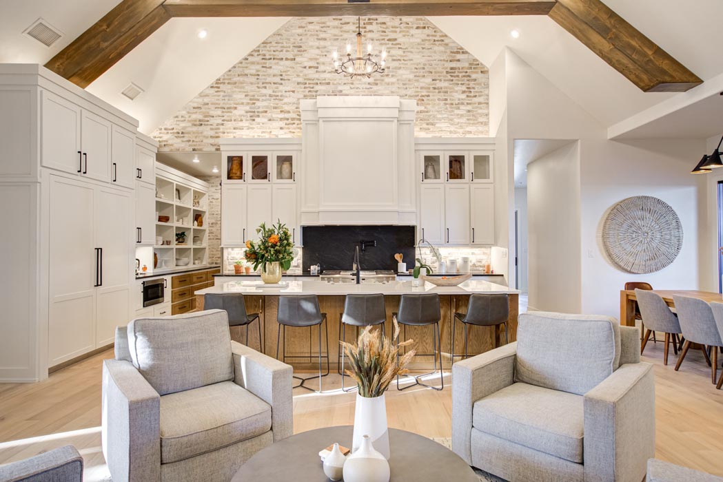 Example of spacious, beautiful living room with vaulted ceiling in new home built by Sharkey Custom Homes in Lubbock, Texas.
