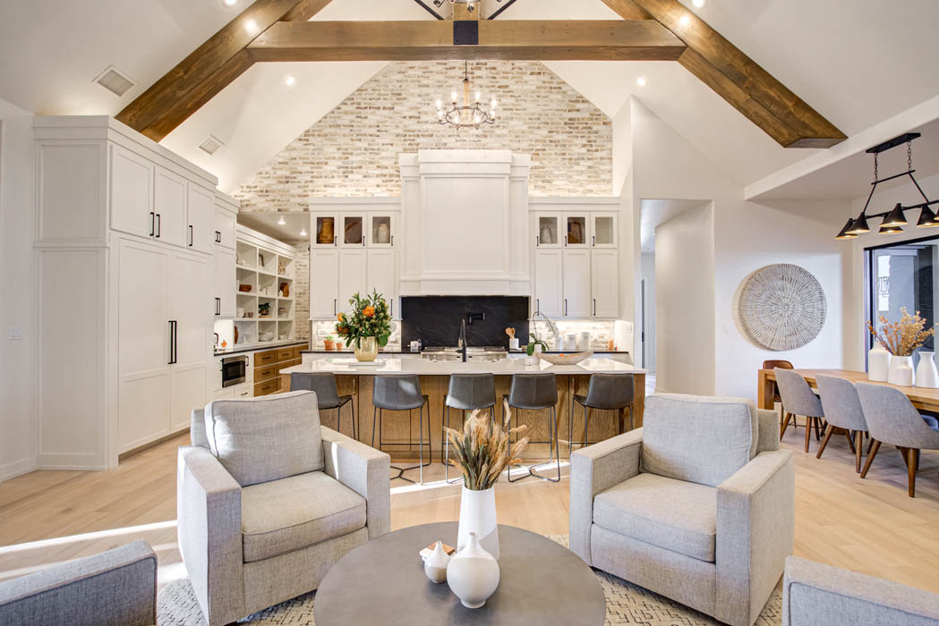Sitting area in open concept living room in custom home.