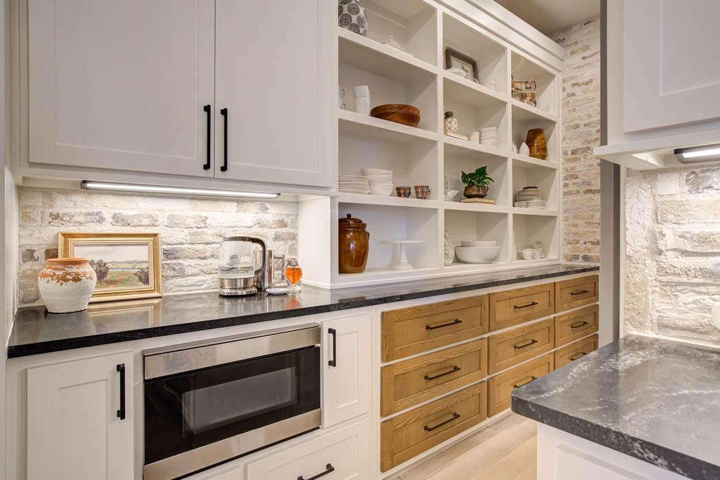 Beautiful kitchen with custom shelves.