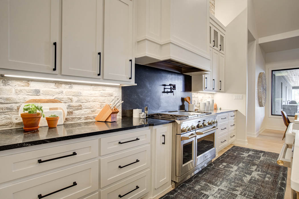 Lots of cabinets in a spacious kitchen, in a custom home near Lubbock.