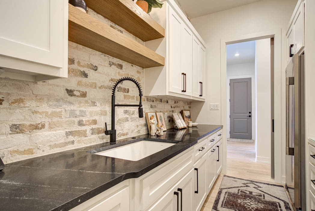 Butler's pantry with sink in custom home near Lubbock, Texas.