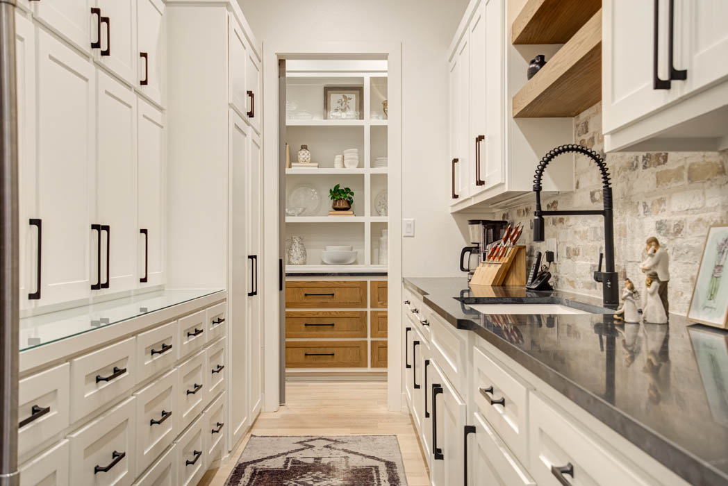 Long view of butler's pantry in custom home near Lubbock, Texas.