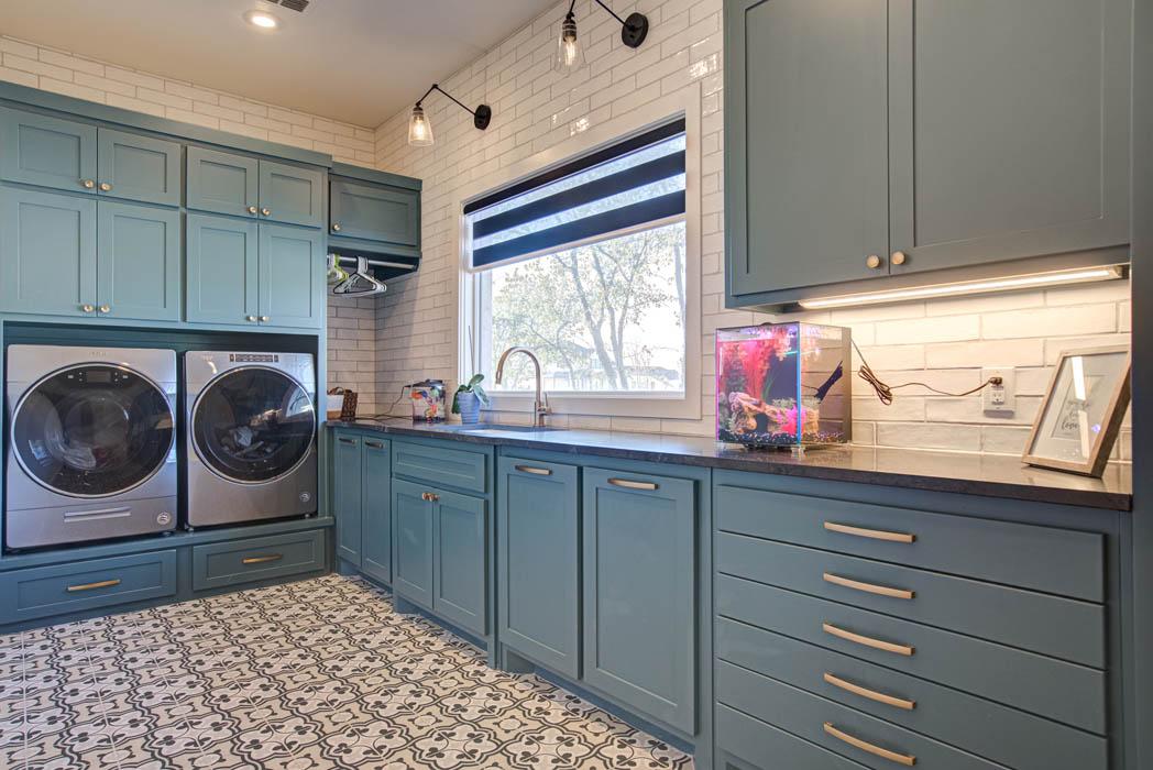 Laundry room area in custom home in Lubbock.