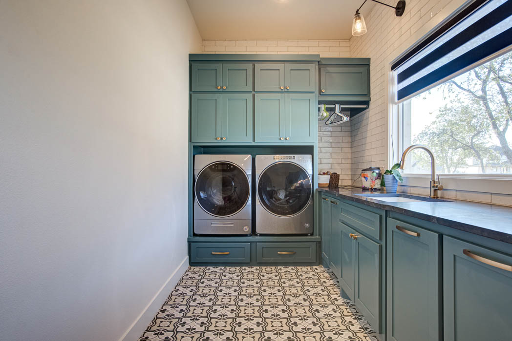 Spacious laundry area in custom home built in Lubbock.