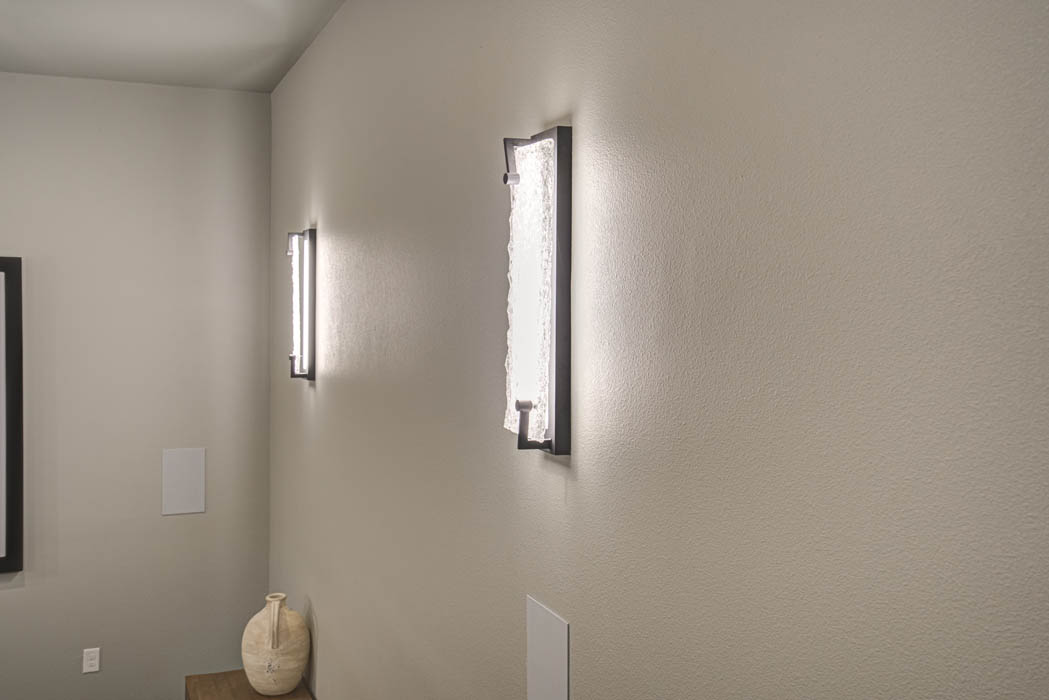 Wall sconces in spacious home theatre in Lubbock custom home.