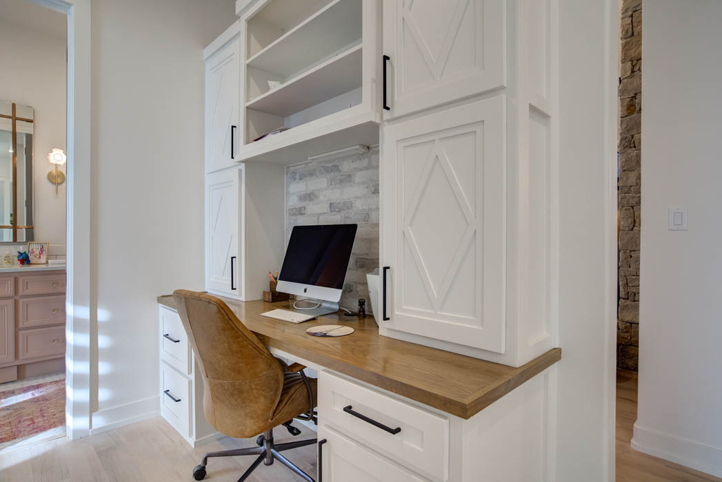 Office in beautiful custom home in Lubbock with built-in workstation.