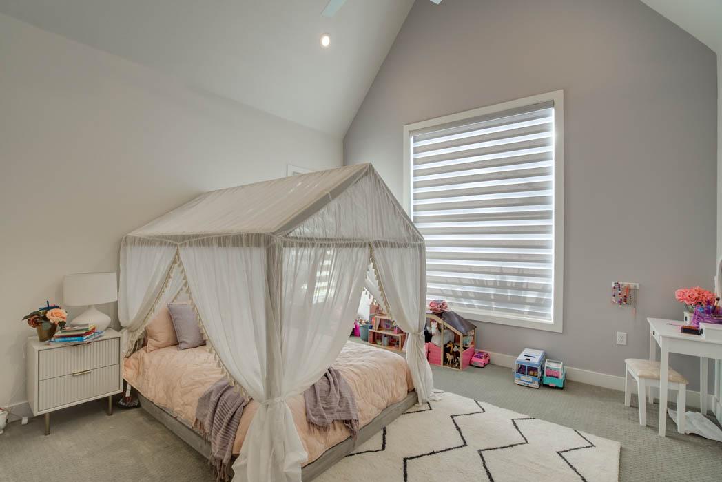 Spacious bedroom in custom home near Lubbock, Texas.