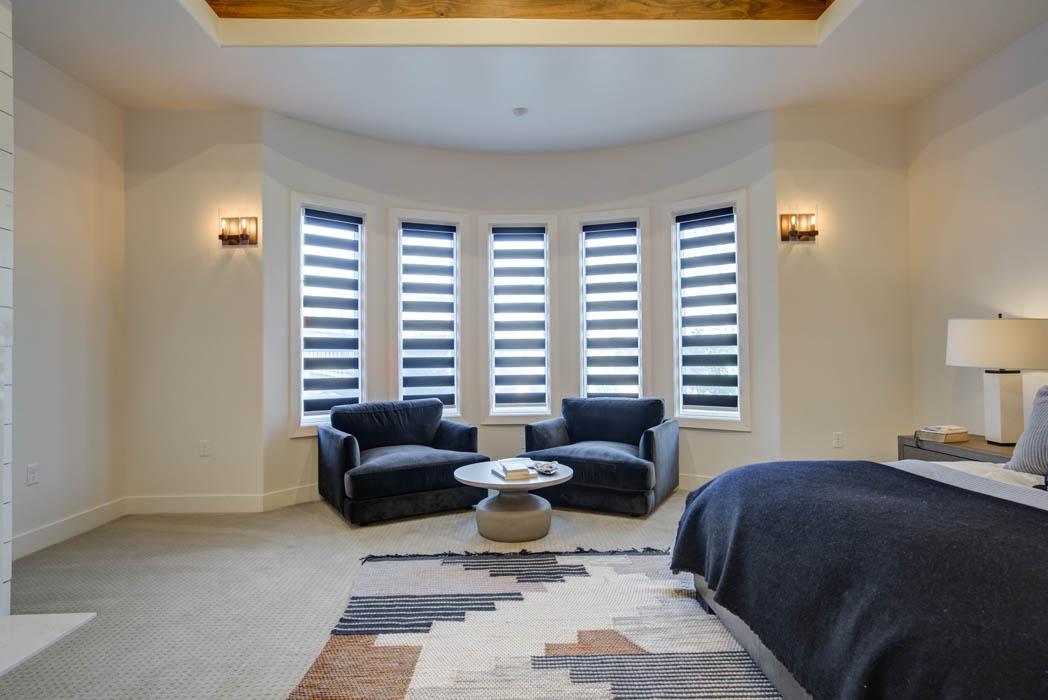 Beautiful bay window sitting area in master bedroom in custom home near Lubbock.