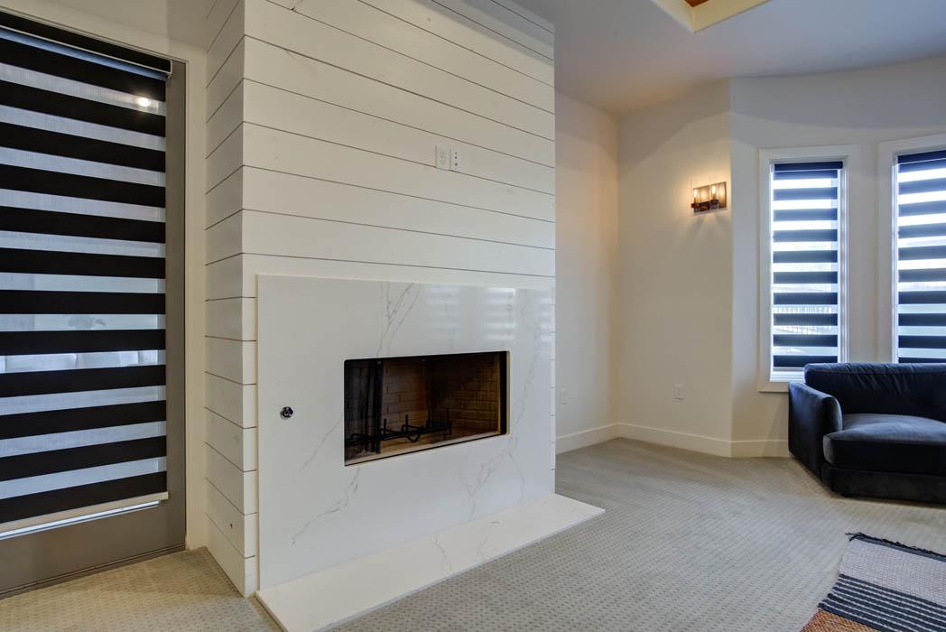 Beautiful fireplace in master bedroom in custom home.