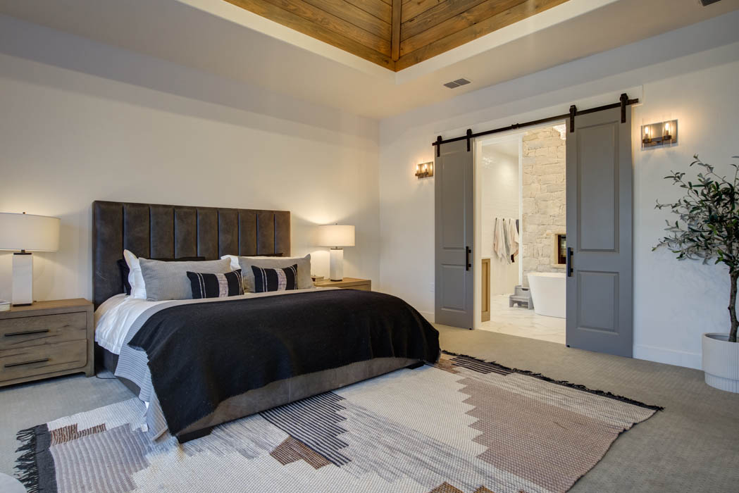 Spacious master bedroom with special ceiling in custom home near Lubbock, Texas.