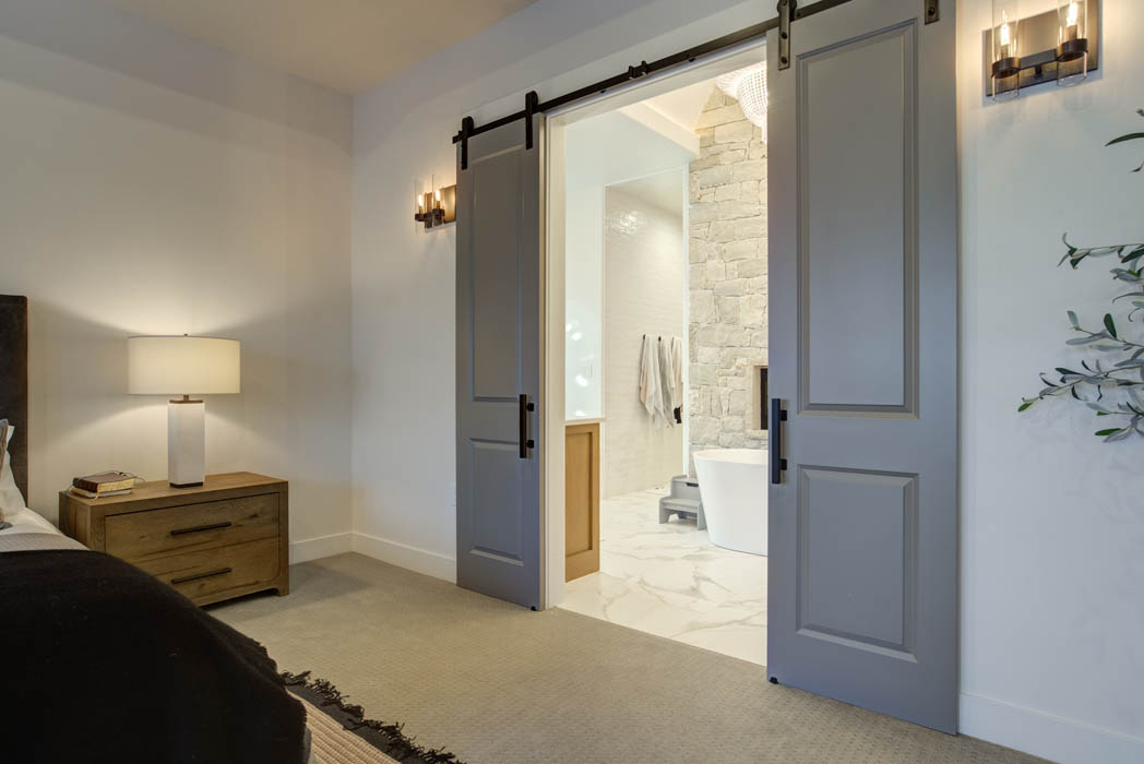 Master bedroom with specialty sliding doors leading to master bath.