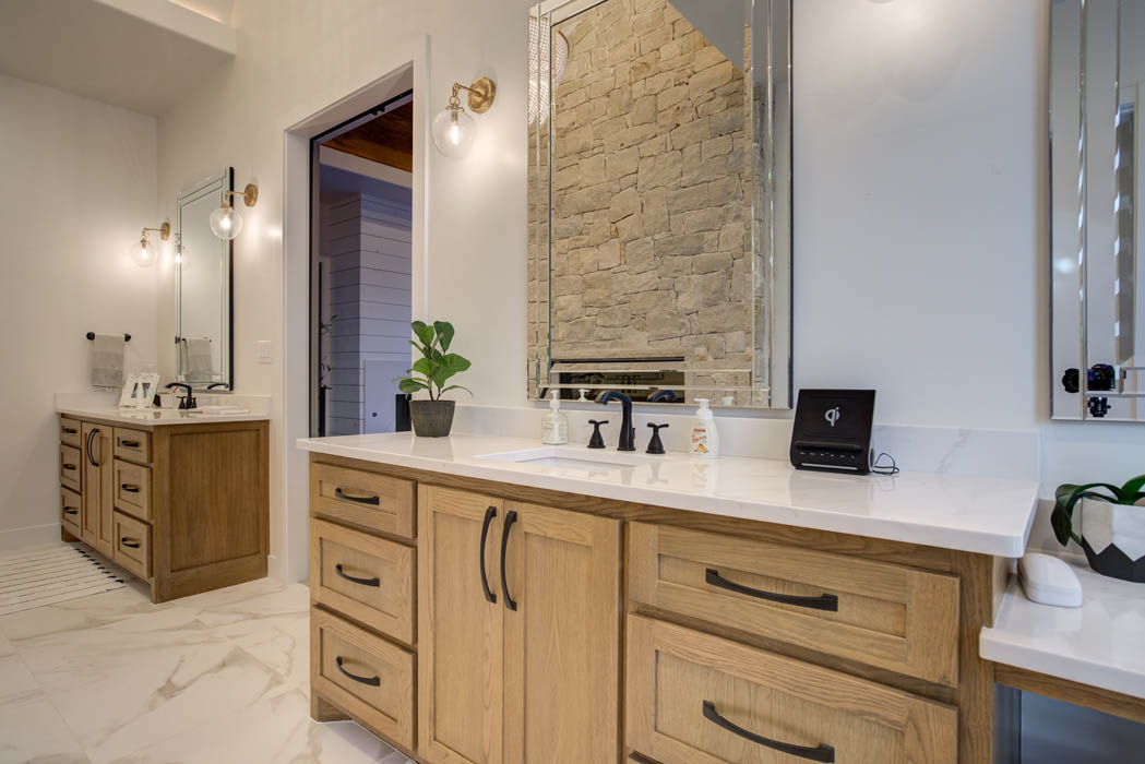 Stone vanities in master bath of beautiful custom home.