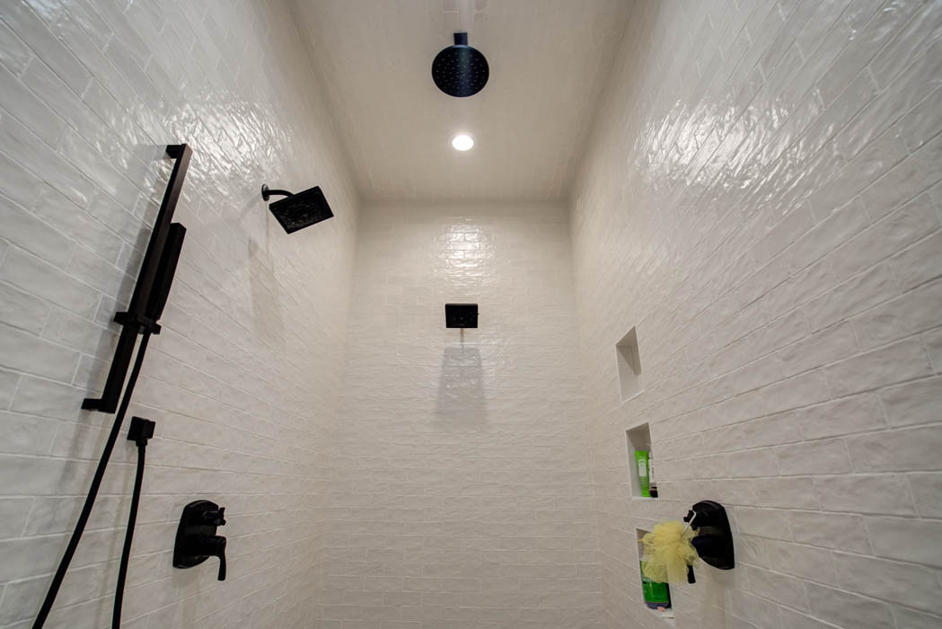 Beautiful custom shower with multiple shower heads, in master bath of custom home.