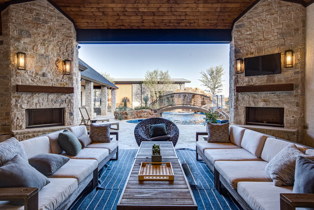 Beautiful outdoor living area with plenty of room to entertain in custom home.