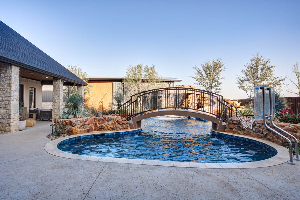 Swimming pool in amazing outdoor space of custom home near Lubbock.