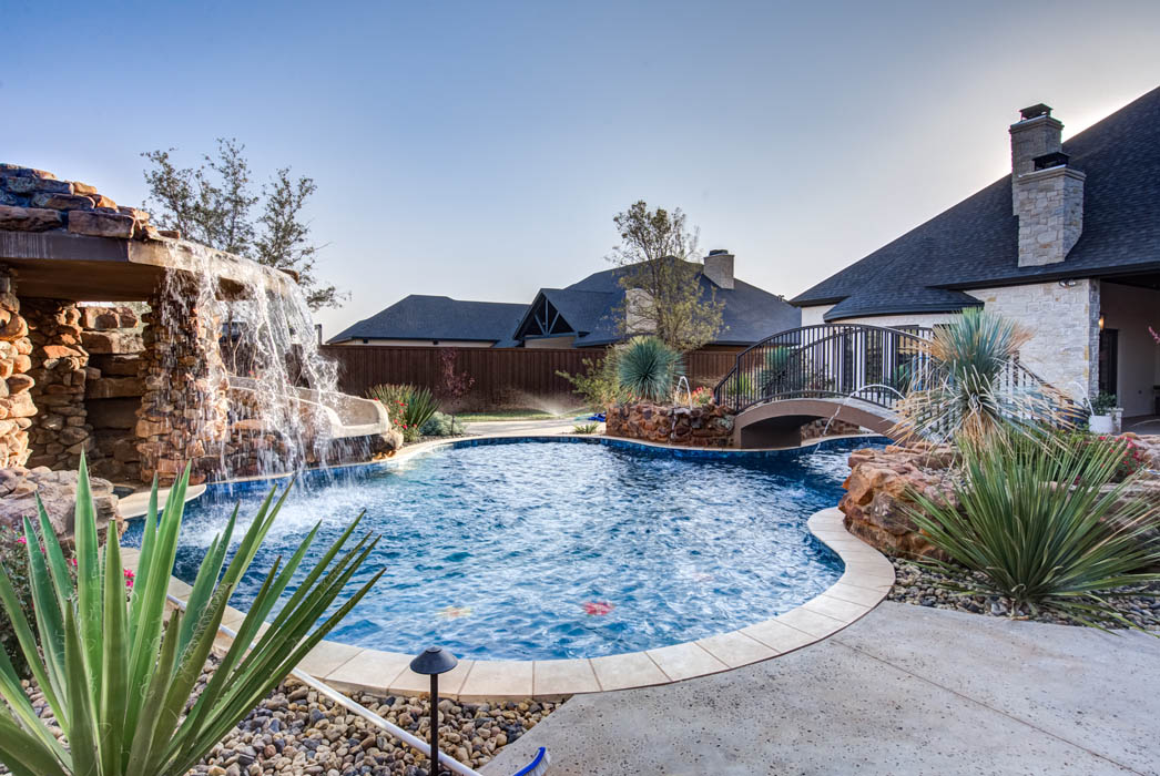 View of swimming pool in custom home near Lubbock.