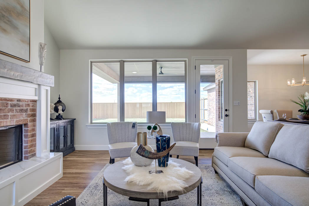 Beautiful living area with large windows in Lubbock, Texas home for sale.