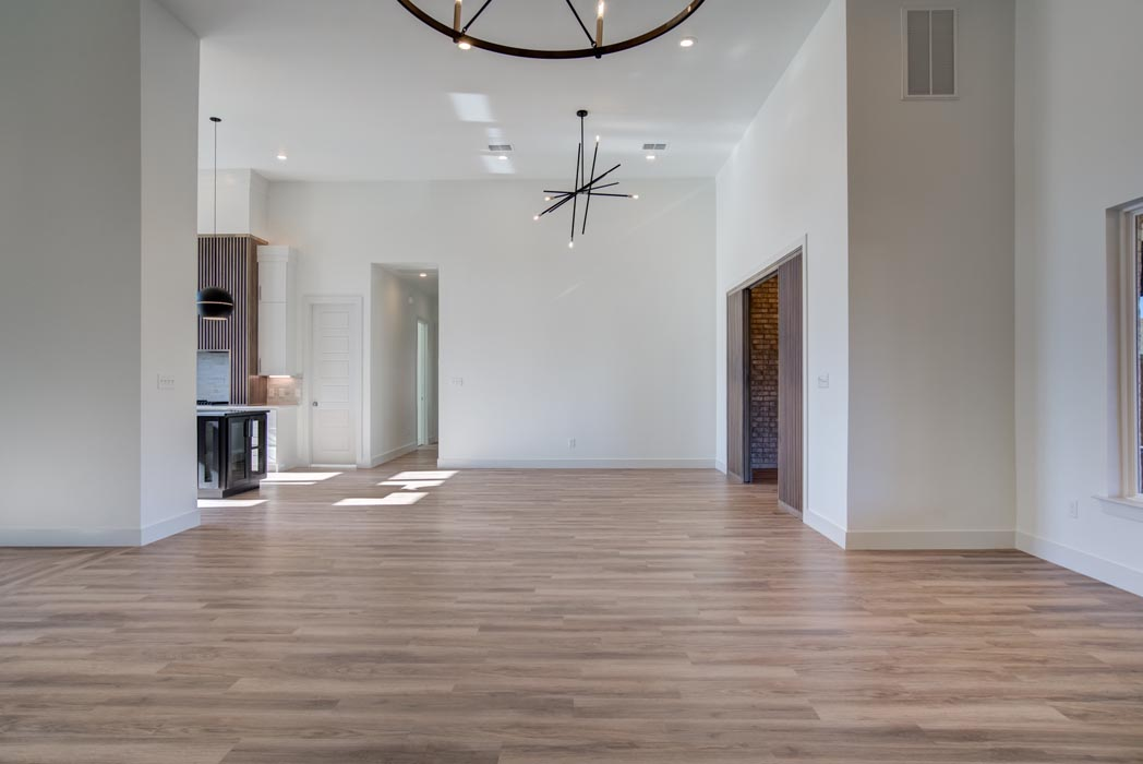 Spacious living room and hall area in new Lubbock home.