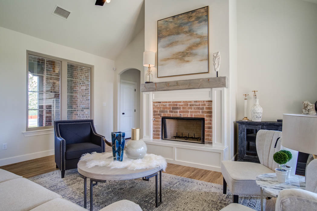 Fireplace in living room of beautiful West Texas home for sale.