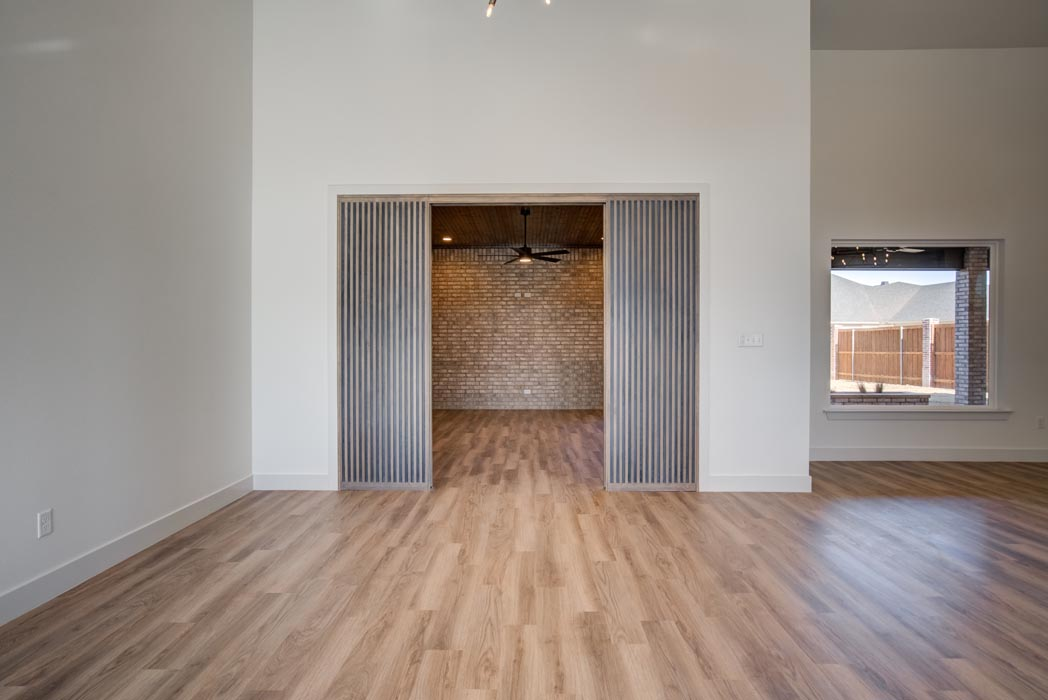 Hall closet in living area of beautiful new Lubbock home.
