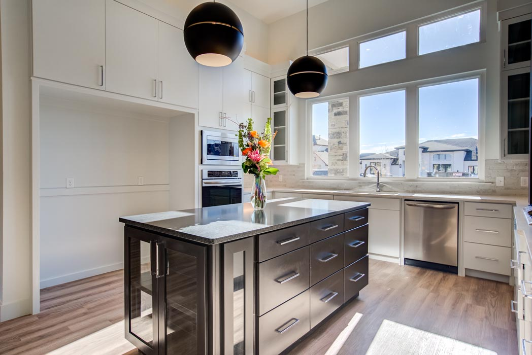 Spacious kitchen in beautiful new Lubbock home, with island.