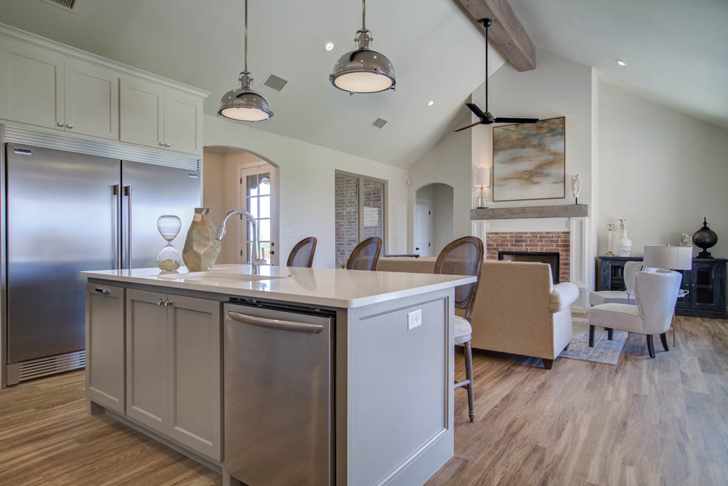 Long view of modern kitchen in new home for sale in Lubbock.