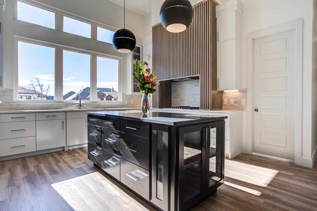 Alternate view of island in modern, beautiful kitchen in new Lubbock home.