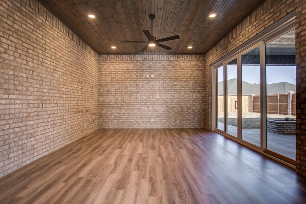 Special enclosed patio area off dining room of amazing new Lubbock home.