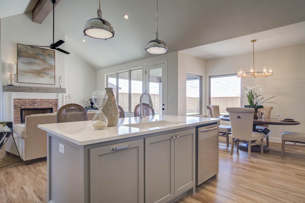 View of kitchen sink island in new Lubbock home for sale.