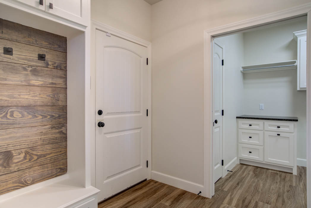 Entry area to laundry-mud room in new home for sale in Lubbock.