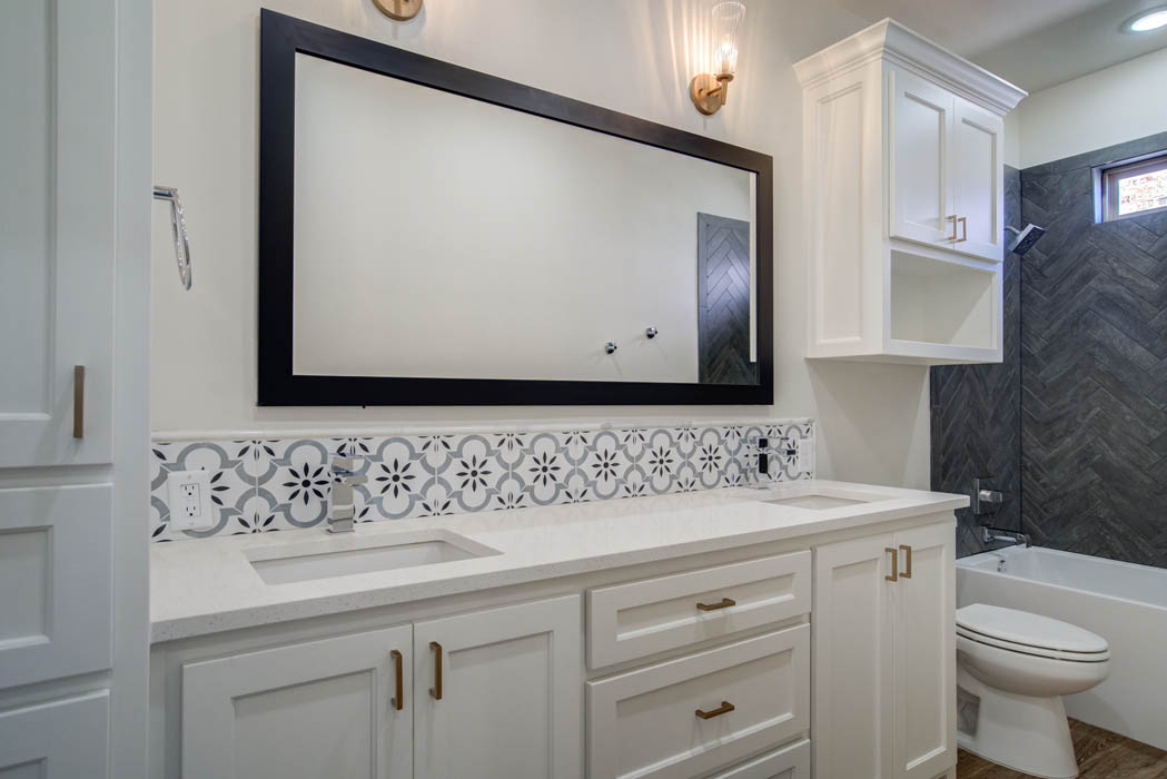 Double vanity in guest bath in new home for sale in Lubbock, Texas.