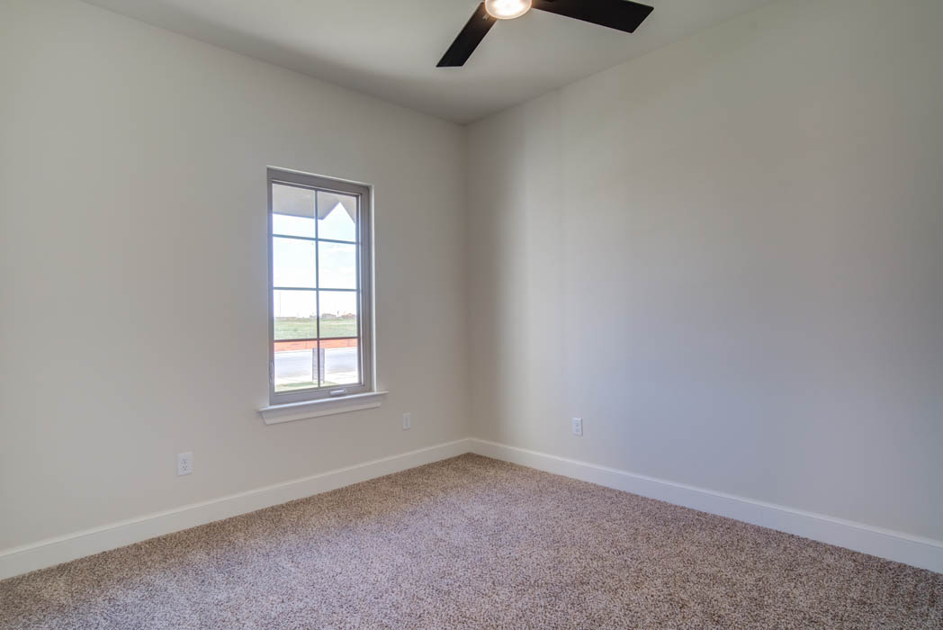 Bedroom or office in new home for sale in Lubbock, Texas by Sharkey Custom Homes.