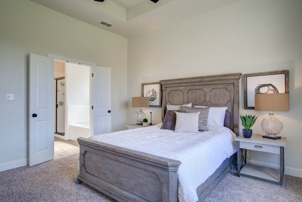 Lovely master bedroom in new home for sale in Lubbock, Texas.